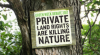 "sign reading ""Private Land Rights are Killing Nature"""